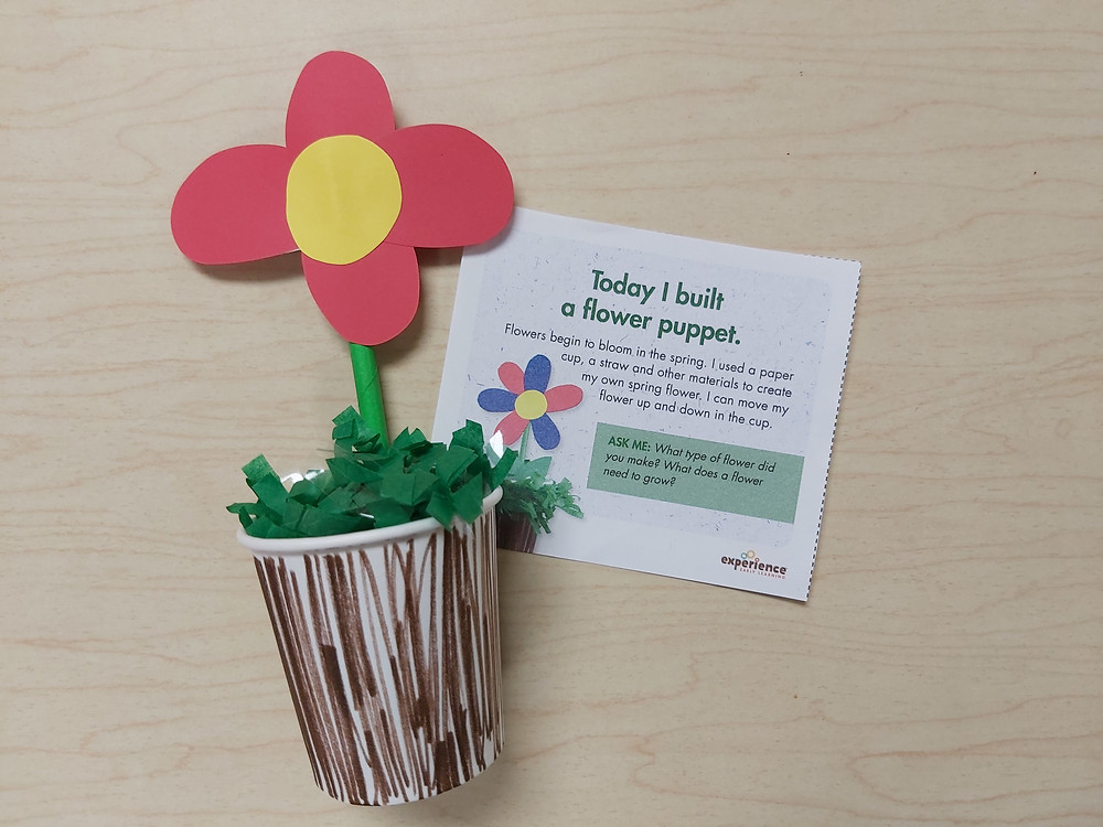 flower puppet with daily note explaining creative art activity