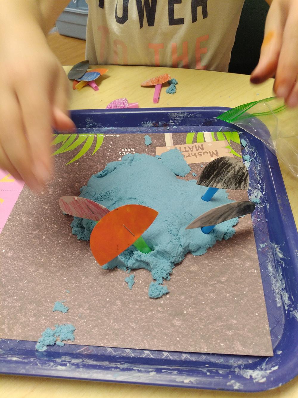 preschool math game using playdough and handmade mushrooms