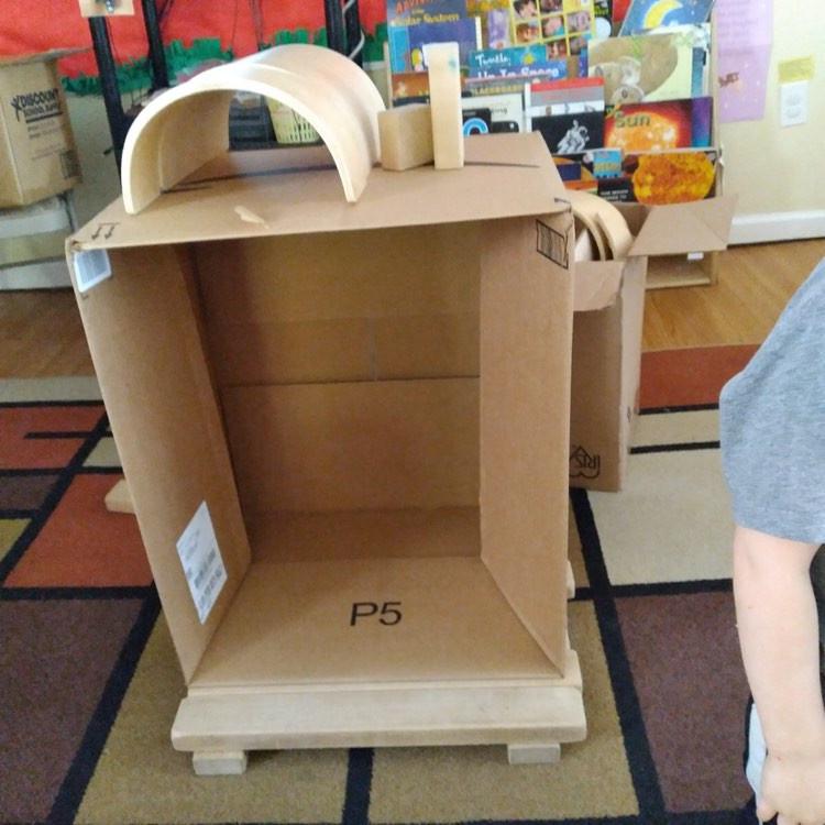 rocket ship made from cardboard box and blocks
