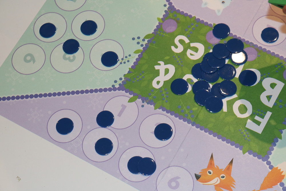 Fox & Berries math game with game pieces scattered