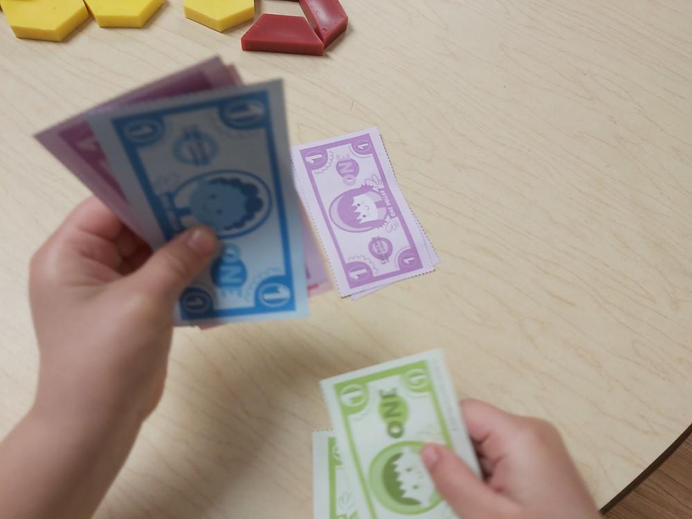 preschooler counting pretend money