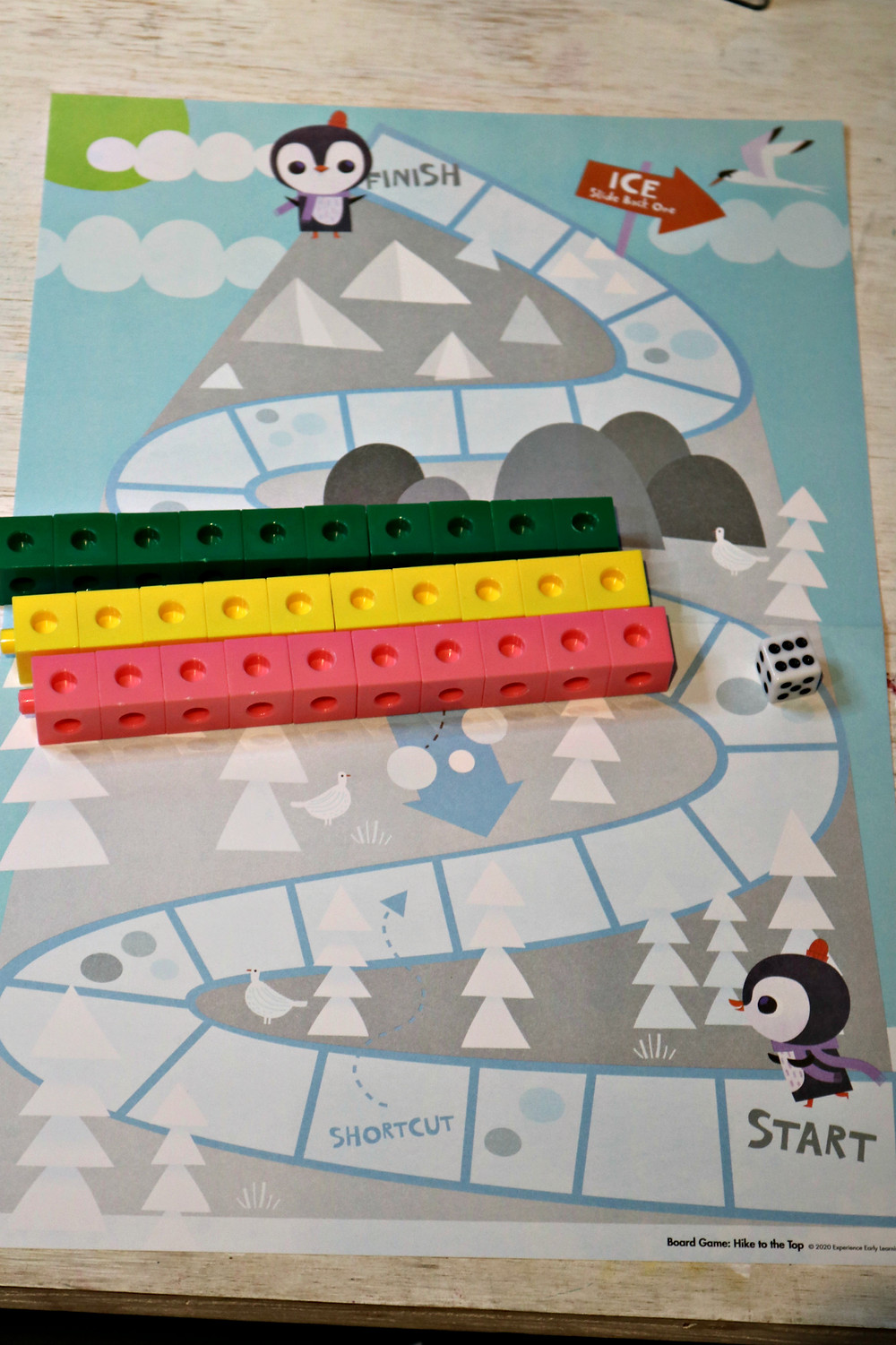 mountaintop board game with cube manipulatives