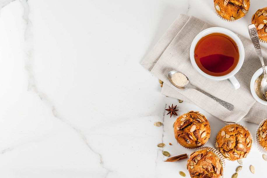 Autumn and winter baked pastries. Healthy pumpkin muffins with traditional fall spices, pu