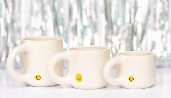 smile mug surprise