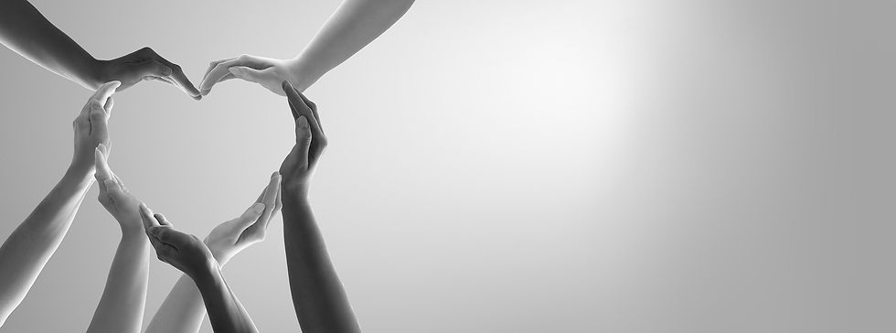 Background image of diverse hands come together to. make the shape of a heart
