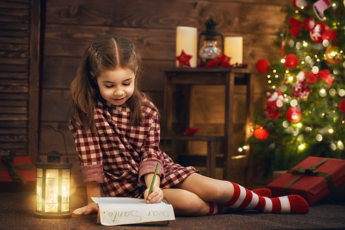 girl-writes-the-letter-to-santa-PD3RSHC.