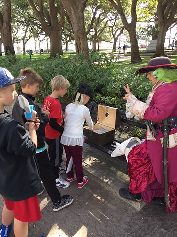 Divvying up the plunder from treasure chest on Children's Tour in Charleston