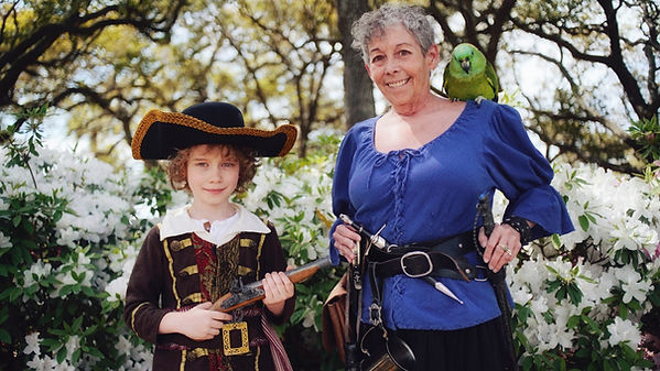Sabrina and parrot with young pirate on Children's Tour