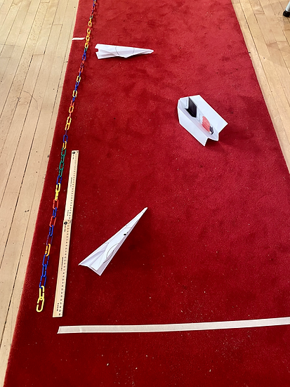 paper airplane on a toy runway.