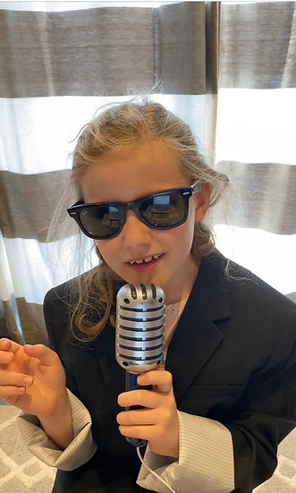 Child dressed up as a newscaster