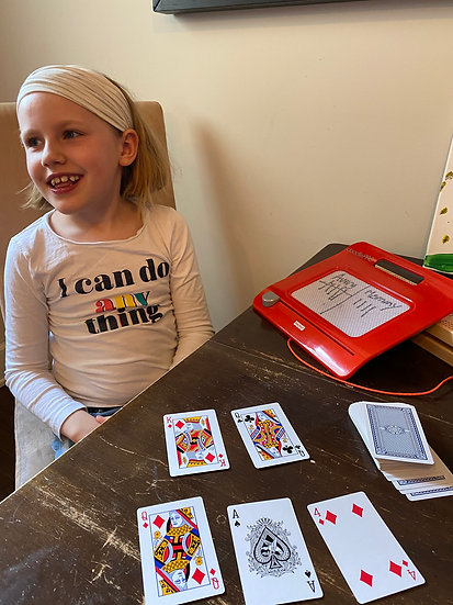 Child and playing cards