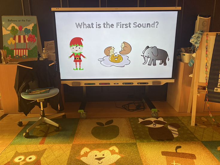 """projector screen with pictures of an elf,  egg, and elephant. Text says """"what the first sound"""""""