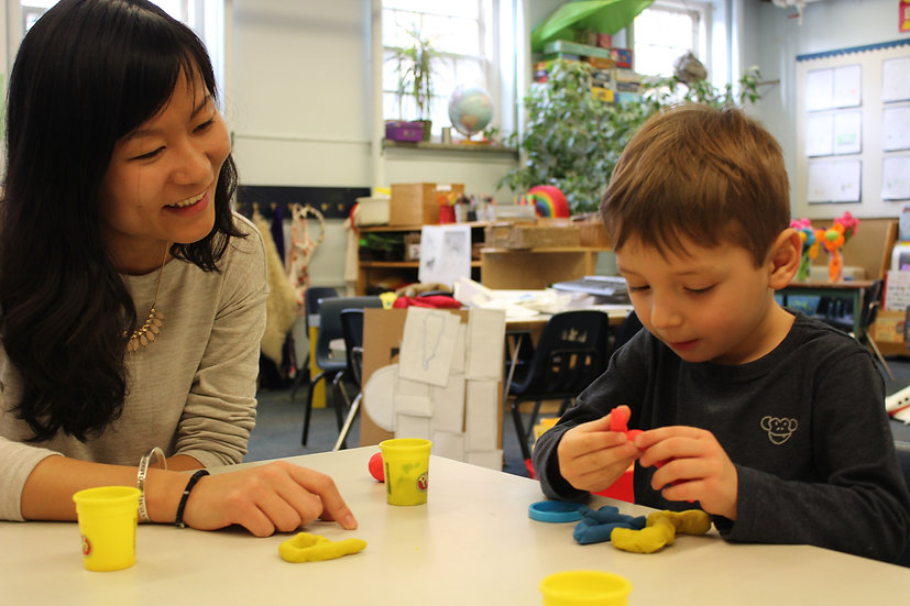 Adult and child playing with playdough