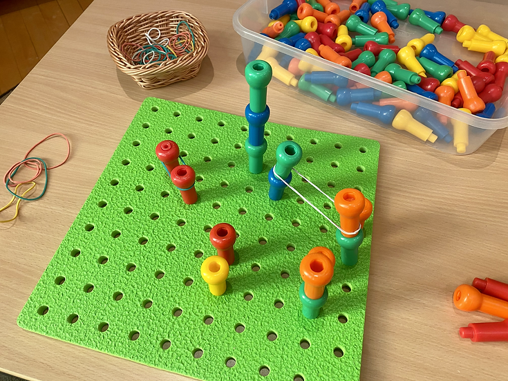 Pegboard on a table in a classroom