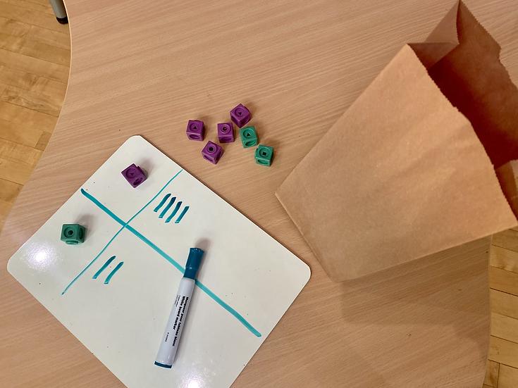 Paper bag, white board, interlocking cubes