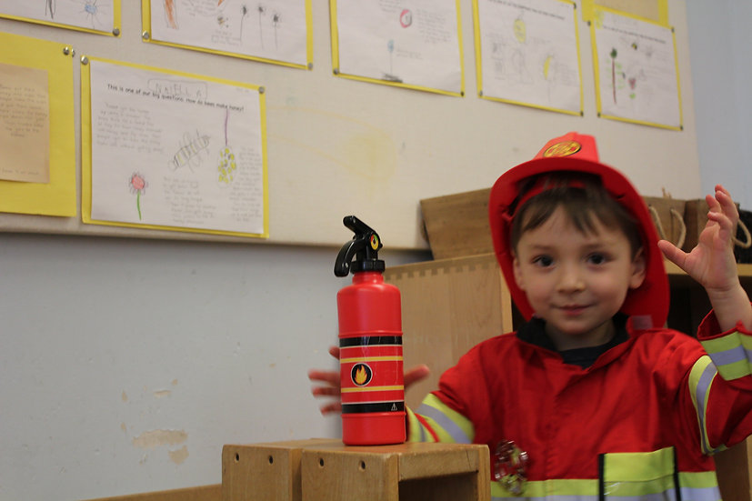 child dressed up as a fire fighter