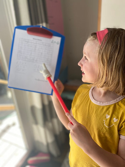 Child pointing to word search