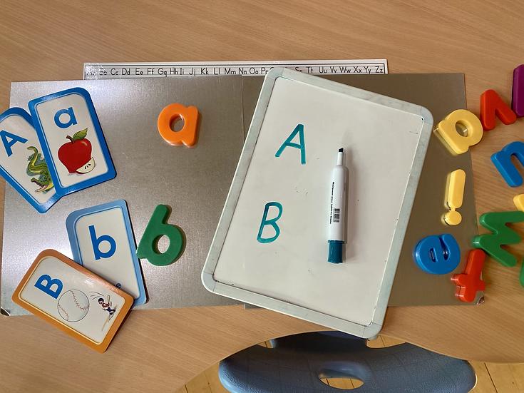 Alphabet chart strip, magnetic letters.