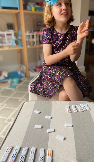 Child playing with dominoes