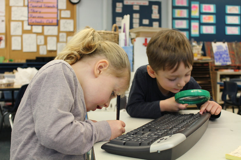 two children playing with keyboard