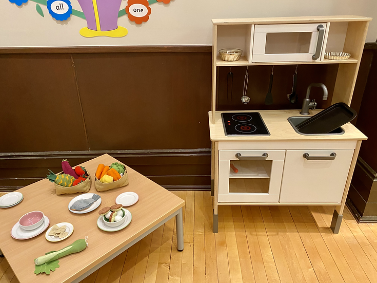 Toy kitchen and table