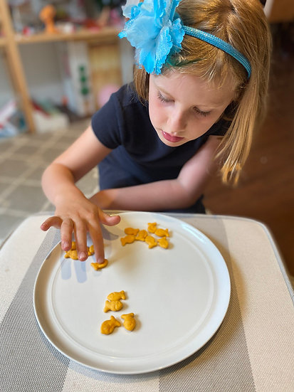 Child playing with goldfish crackers