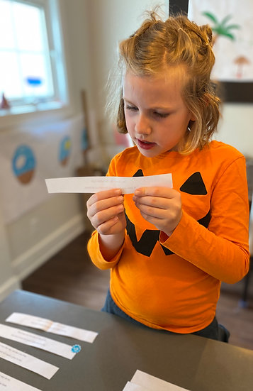 Child reading clues on a piece of paper