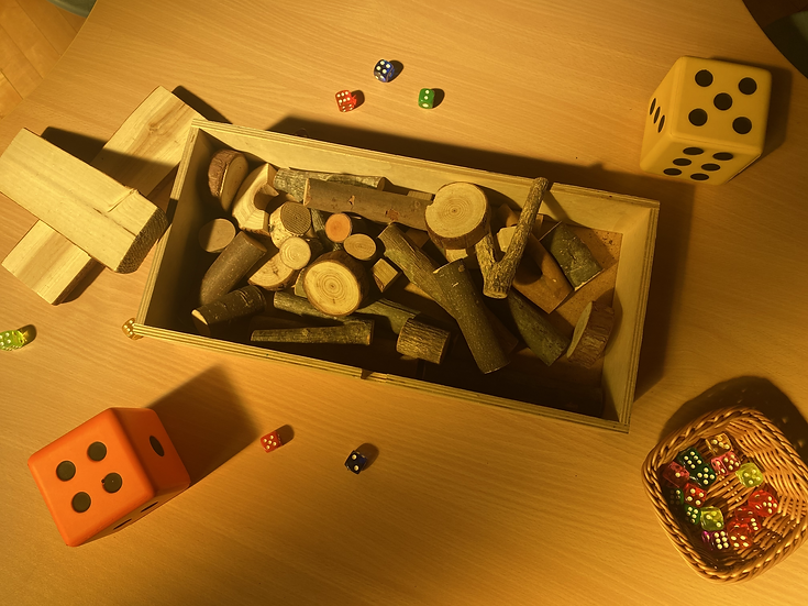 wooded sticks and dice