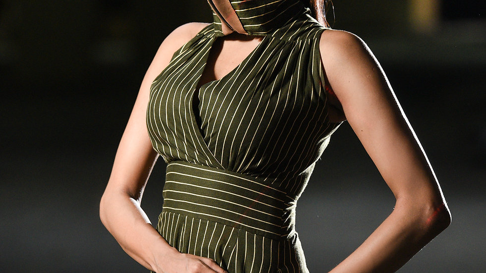 Pinstripped jumpsuit with inbuilt mask with leather detailing