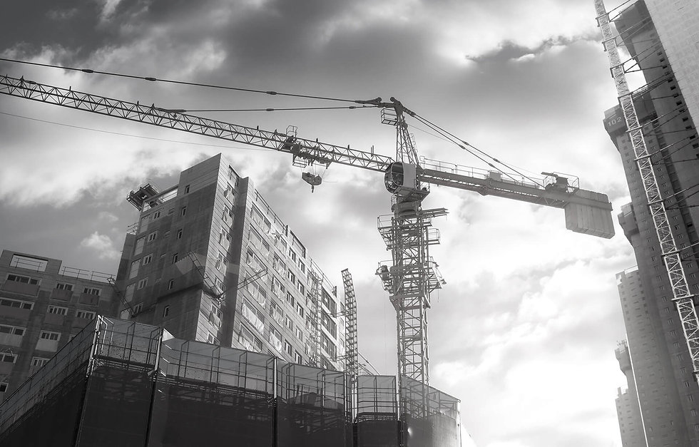 background image of a tower-crane in a construction field