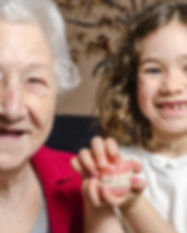 Grandmother and granddaughter both showi