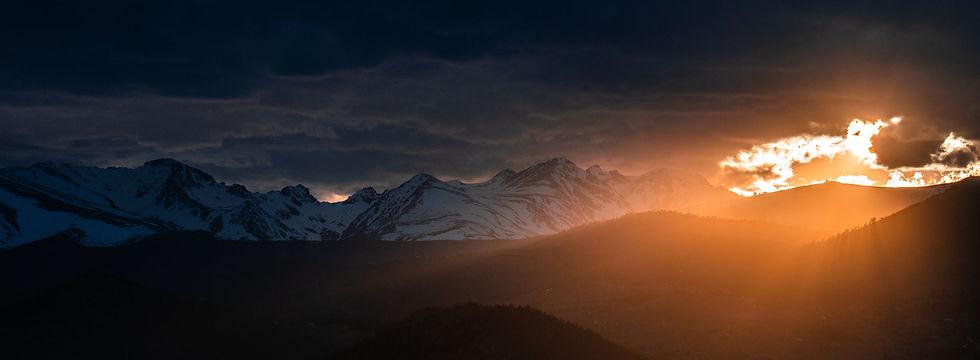 sunset behind clouds_2450x900.jpg