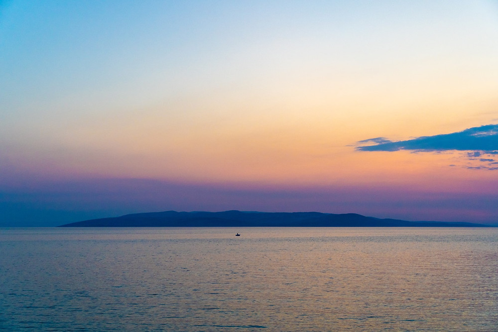 Stunning sunset view of Island Brac from Makarska beach in Croatia