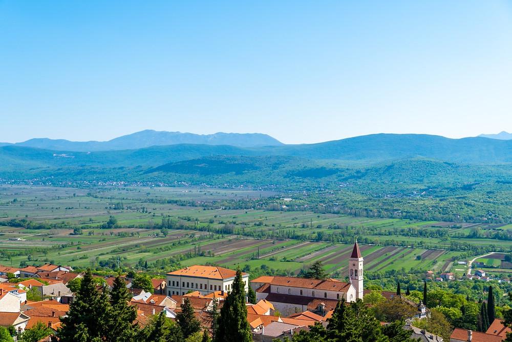 Panoramic view over the city Imotski and valleys towards Biokovo mountain