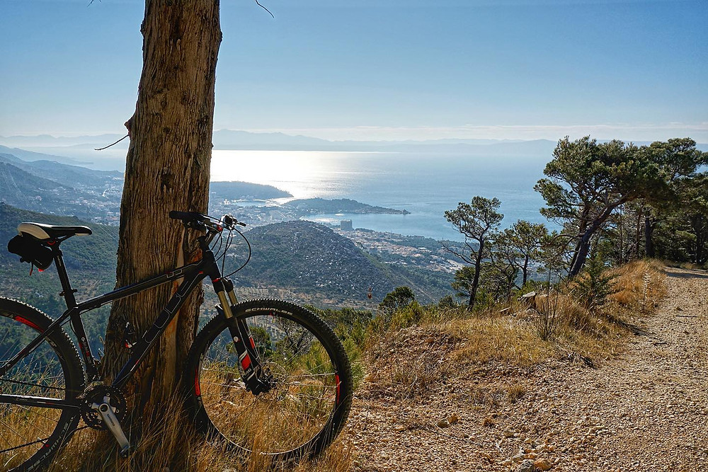 Bike leaning on a tree above Makarska Riviera
