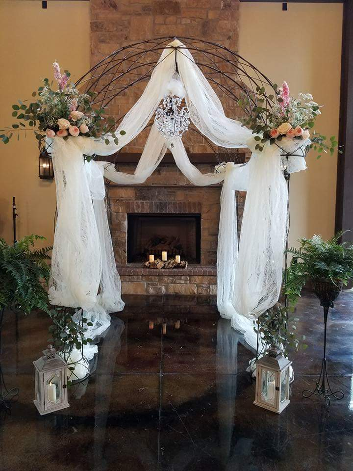 Alter Arch with Floral Arrangements