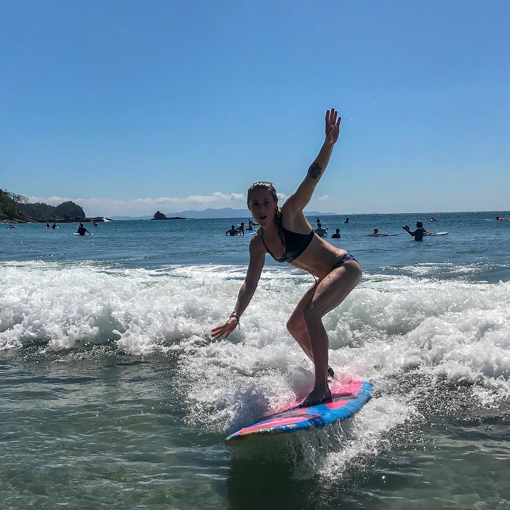 Catching waves in Playa Maderas