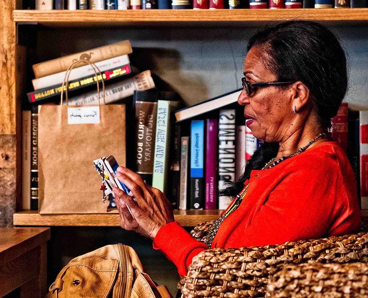 Lower rez elder lady in front of books.j