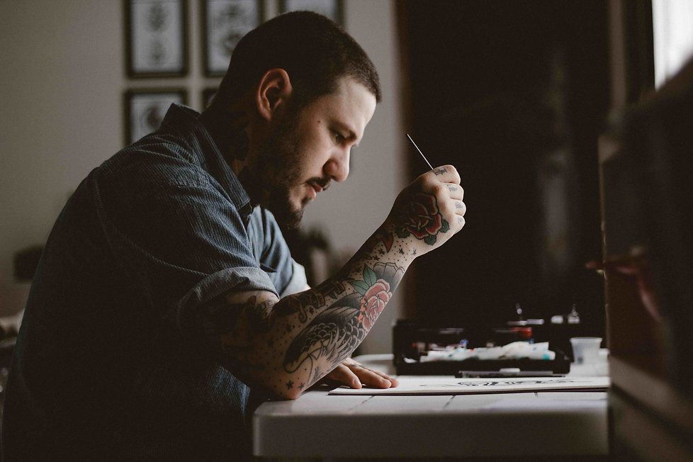 Tattoo guy writing.jpg