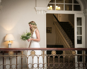 wedding photograph of the bride entering the wedding venue at the stunning  Storrs Hall