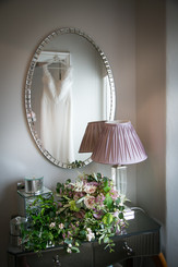 beautiful wedding dress hanging at the stunning Belsfield Laura Ashley Hotel Bowness