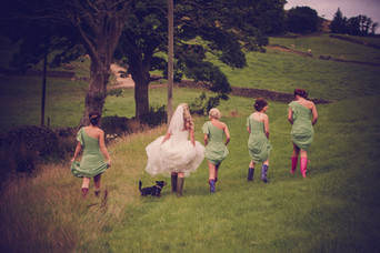 wedding photography of bridesmaids in wellies