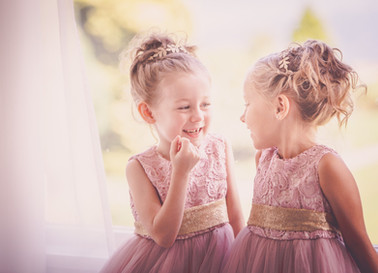 A lovely wedding picture of the little flower girls chatting at Inn on the Lake Ullswater