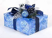 blue christmas gift with silver pinecone decorations