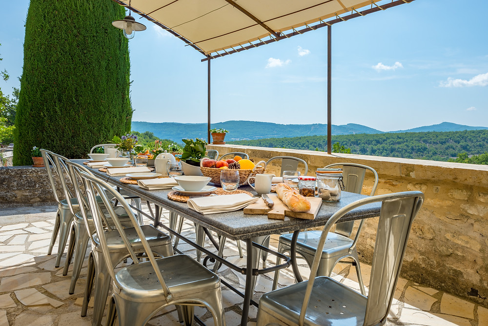 La Bastide de San Sebastien's outdoor dining terrace seating up to 10 people with views over the Luberon National Park in Provence, France