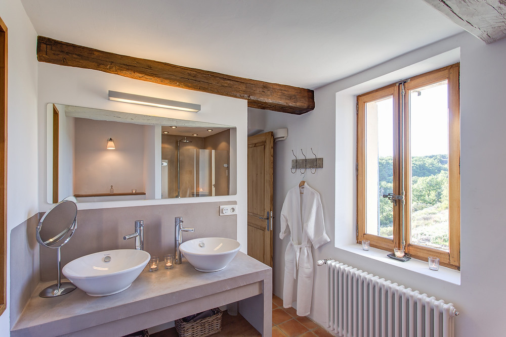 Modern luxury ensuite bathroom at La Bastide de San Sebastien with views over the Luberon National Park and Provence countryside