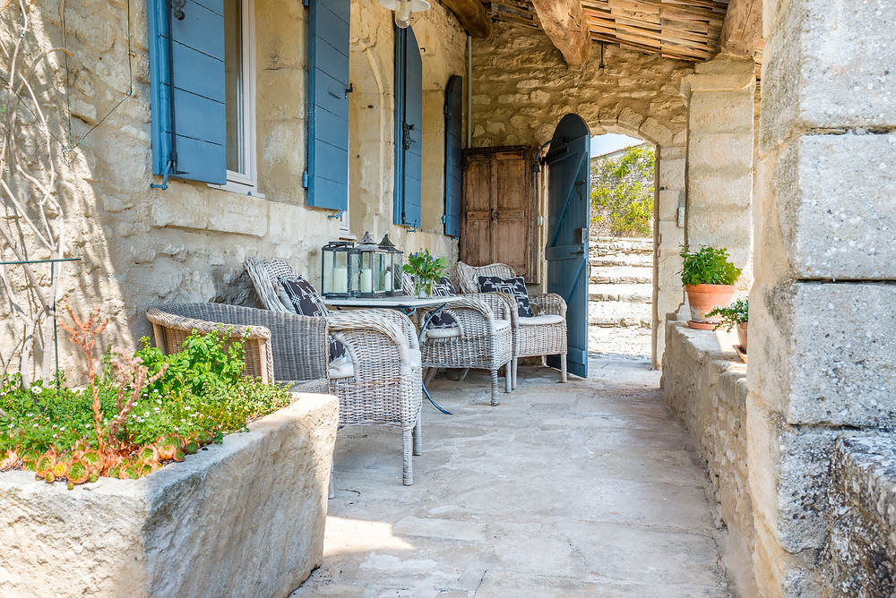 Read Peter Mayle's A Year in Provence overlooking the villa's 14th century medieval courtyard