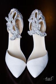 wedding bride shoes white details shot.j