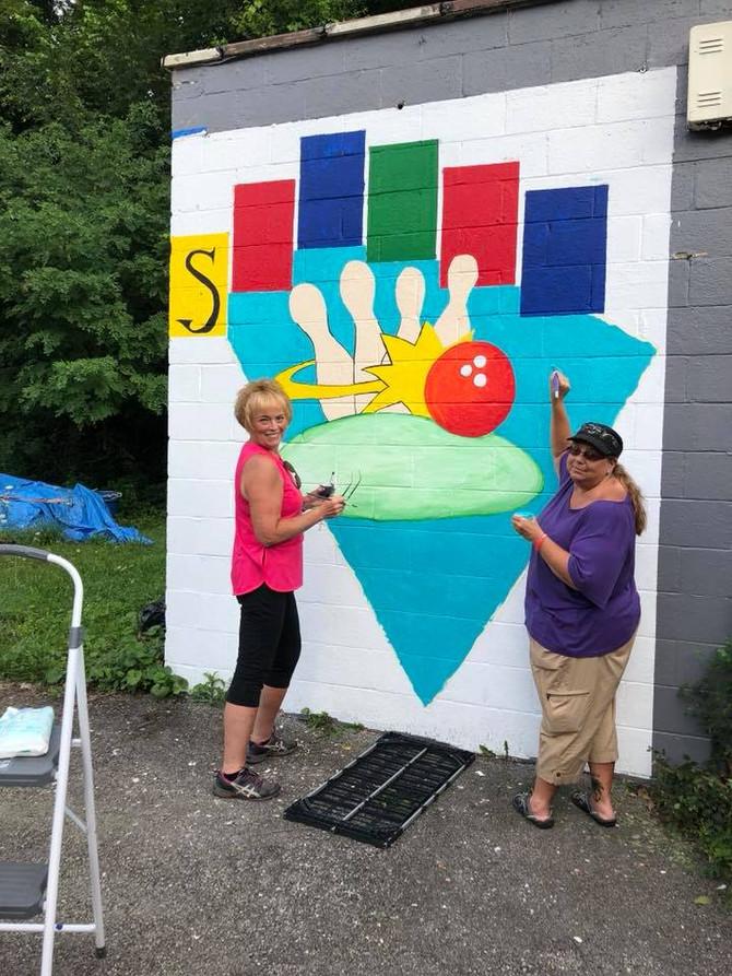 Volunteers work hard to brighten up Penn Hills Businesses.  Sophies Lanes