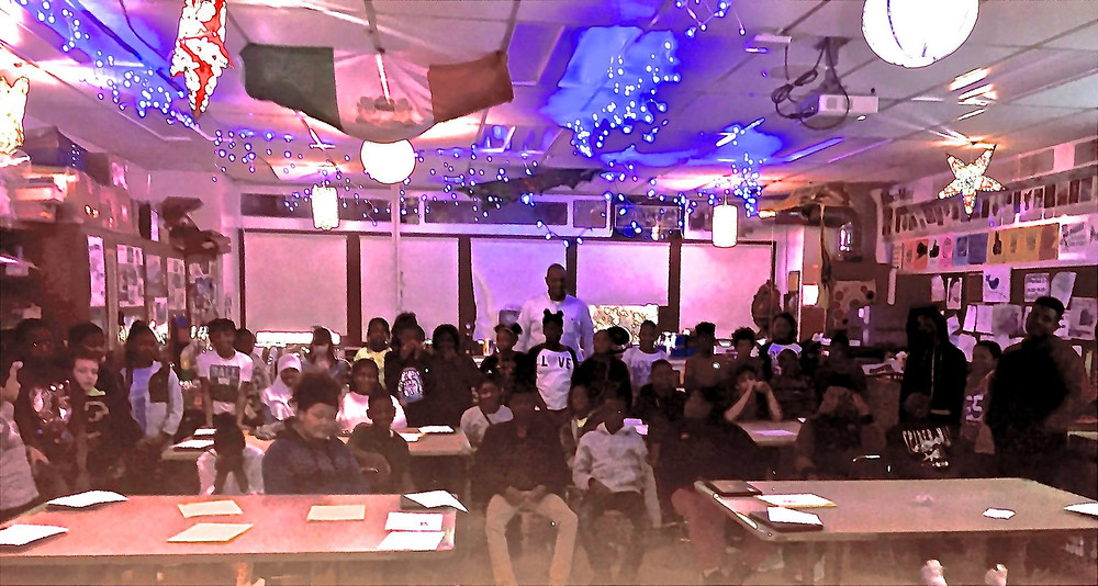 Marlon Ferguson / Executive Director Veterans Place answered questions from students after youth worked on stars for the Star Tree Program that provides gifts for homeless Veterans.